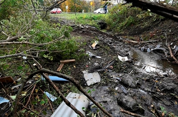 Debris scatters an area at the site of yesterday's fatal crash in Schoharie, N.Y., on Sunday, Oct. 7, 2018. A deadly crash involving a stretched limousine-style SUV in New York state over the weekend has put a spotlight on safety concerns around the modified vehicles, but companies in the industry maintain that they're safe. THE CANADIAN PRESS/AP, Hans Pennink