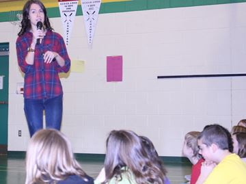 April Reimer speaks to Birchview Dunes' students