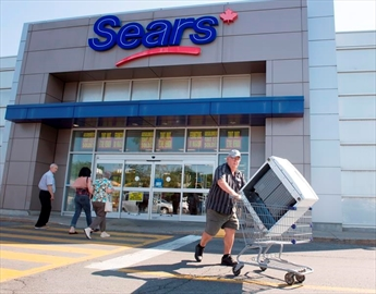 Bargain hunters are seen at the Sears store Friday, July 21, 2017 in St. Eustache, Quebec. Dozens of Sears stores across the country destined for closure will begin liquidation sales today. THE CANADIAN PRESS/Ryan Remiorz