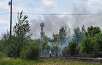 Bush fires rage