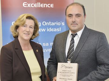 Ontario Lamb Company owner Nick D'Elia accepts the Premier's Award from Oak Ridges-Markham MPP Helena Jaczek.