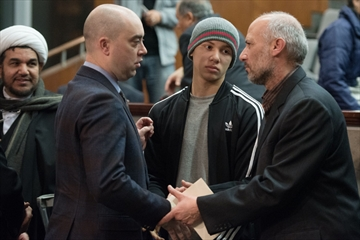 Hamilton Police Det. Sgt. Steve Bereziuk, left, meets with Yosif Al-Hasnawi's father, Majid Al-Hasnawi, right, and brother Madhi Al-Hasnawi.