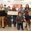 Meaford Goldenaires donate to MCS music program