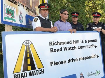 New Road Watch sign