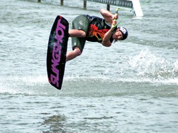 Kirby Kostuk uses his own wake to get some air. Kostuk competed in the intermediate men's division.
