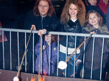 Stephanie Leutner, her daughter Maya, Destiny Beke, and Rebecca St. Germaine roast marshmallows at the Winter Wonderland event at Chinguacousy Park on Wednesday night.