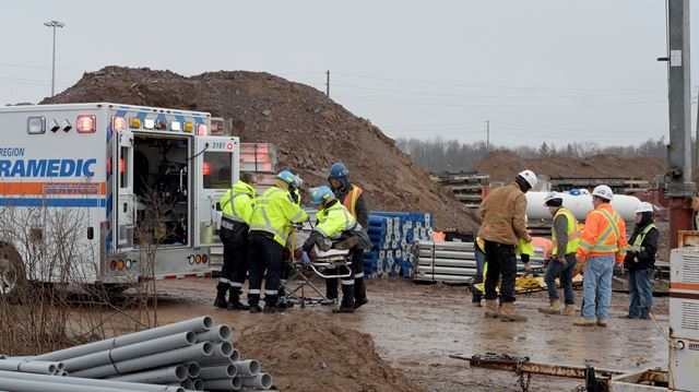 Construction crane used to help stricken worker at new Halton police headquarters site