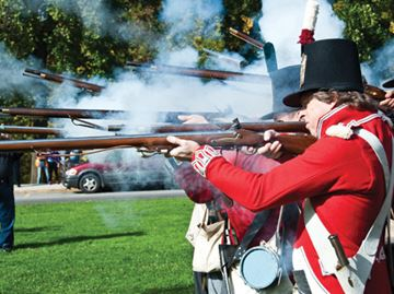 Second Lincoln Militia re-enactors perform a 21-gun salute