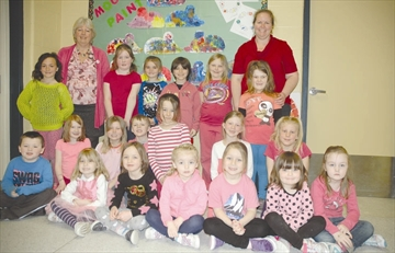 Shown here with their teachers Mrs Purdy (left) and Mrs. Case, the Kindergarten and Grade 1-2 students at Montague Public School got right into the spirit of anti-bullying, sporting their best smiles and pinks on Wednesday, April 9.
