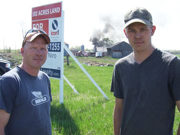 Farm hands helped pull truck for shed before it was engulfed by flames.