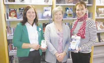 Clare Weissflog of Sustainable North Grenville presents library staff, Liz Dwyer and Patricia Evans with two Hampton Energy Monitors. The energy monitors can be borrowed by anyone with a library membership for up to three weeks. See page K15 for more details.