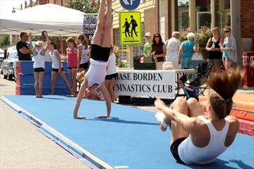Members of the Borden Gymnastics Club display some of their mat routines.