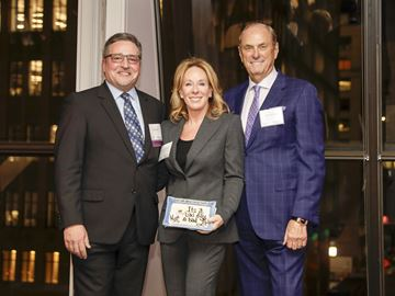 Brian Hansell (left) presents CAMH 150 Difference Makers co-chairs Sandi and Jim Treliving with the 400th Convo Plate.