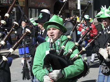 Members of the St. Andrews Pipes and Drums make their way down Yonge Street during the St. Patrick's Day parade Sunday.