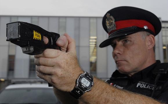 000 Gallery Putting Stun Guns  Hands  Front Line Waterloo