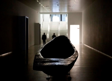 A wooden canoe, carved out of one piece of wood, in the main underground hallway leading to the Africa Museum in Tervuren, Belgium, Friday, Aug. 3, 2018. The museum is reopening on Saturday Dec. 8, 2018, after more than 10 years spent revamping the building and overhauling its dated, one-sided approach to history. (AP Photo/Virginia Mayo)