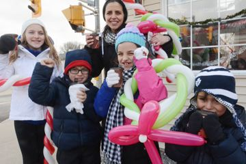 Laura Leoni, and her crew of Alexandra Fachinni, Luca Leoni, Stephanie Facchini and Matteo Leoni, all of Woodbridge, cheer on Christmas.