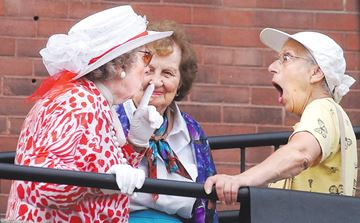 Helen Gross, left, spins quite a yarn to her amazed friends Velma Gray, centre, and Rita Stones on Main Street in Newmarket, Ontario. This image won in the feature photo category of the Ontario Community Newspaper Awards.