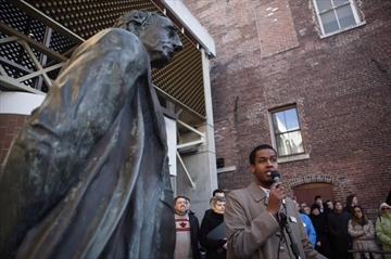 A statue of Sir John A. MacDonald overlooks the Imam at Masjid Al-Iman, Ismail Mohamed Nur, as he speaks to supporters and to the city of Victoria and the Muslim community during a vigil to honour the victims of the Quebec City mosque shooting in Victoria, B.C., Tuesday, January 31, 2017. The mayor of Victoria says a statue of Prime Minister John A. MacDonald will be removed from the front entrance to city hall as a gesture of reconciliation with First Nations. THE CANADIAN PRESS/Chad Hipolito