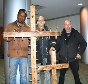Jeff Vanderwiele, right, was joined by supporters Stephen Gordin and Torin Van Loon, as he prepared to pitch his business, God's Genesis Garden Grow Group, to Dragons' Den producers at the Scotiabank Convention Centre on Saturday.