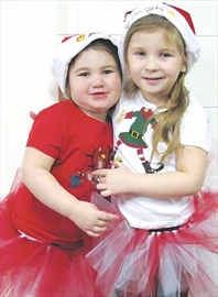 Sisters Alyssa, 3, and Kayleigh, 5, Mathews were dressed as holiday princesses in tutus made by their mom for the Leaps and Bounds Children's Centre breakfast with Santa at the Christian Education Centre. Their mother is centre employee Tammy Hodges. For more, see Page 17.