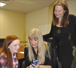 Community - BOOKITTALENT held a casting call at the North Grenville Municipal Centre March 1. Above, owner-agent Pat Jarosz, centre, along with her Ottawa partner Dana Ellis, right, shows young Paige Medynski, who Jarosz represents, her new headshots.
