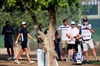 Caddie dies, 1st round stopped and event shortened in Dubai-Image1