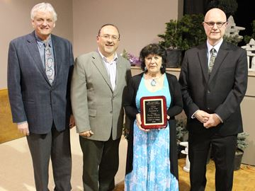 Valerie Bailey-Phillips with Bill Courtnage Memorial Citizen of the Year award