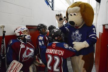 Toronto Marlies mascot Duke offers high fives to  the Toronto Avalanche atom 'A's Jordan Abramovitch, Jordan Buchanan and Jimmy Sauder before joining the Marlies' for their community practice at Canlan Ice Sports on Tuesday. (Dec. 10, 2013)