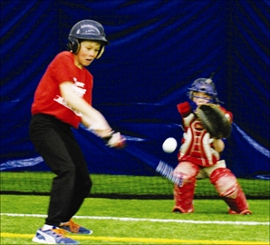 Young baseball players from the Kingston Thunder got some help with their spring training at the Westbrook Sports Dome on Mar. 29 from members of the Kingston Ponies and Queen's Gaels baseball team. Above: Ben Spicer takes a swing during Kingston Thunder spring training at the Westbrook Sports Dome.