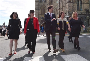 Status of Women Minister Maryam Monsef, left to right, Minister of International Development and La Francophonie Marie-Claude Bibeau, Prime Minister Justin Trudeau, Sophie Gregoire Trudeau and Women Deliver President and CEO Katja Iversen arrive at an event in Ottawa on Tuesday, June 13, 2017. The Liberal government is thinking about using its massive purchasing power to support women in business. THE CANADIAN PRESS/Sean Kilpatrick