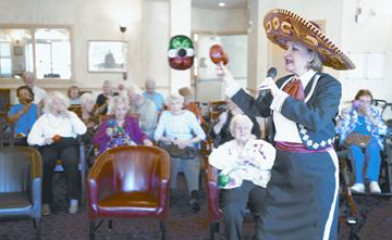 Marie Gogo, right, entertains at Scarborough's Retirement Suites by the Lake during a party to celebrate Cinco de Mayo.