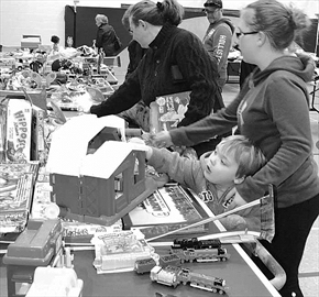 Decisions. Decisions. There were so many toys to choose from at the McNab Public School mega garage and bake sale Saturday morning, children and adults alike had no problem finding that perfect treat.
