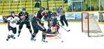 Chasing the loose puck