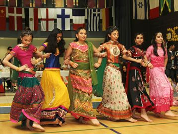 Students, from left, Sanaea Suntok, Shriya Paturu, Maya Verma, Kavya Sony, Aisha Ladha and Ariana Jaspal perform a traditional dance.