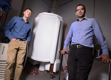 Photo of Jake Windsor and Hazem Mazhar with a prototype of a hybrid geothermal system.