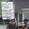 John Fox protests outside the shelter on Mother's Day.