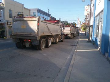 Truck traffic through Acton