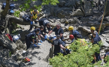 Firefighters prepare to lift woman from the river bed of Albion Falls after a fall in early June.