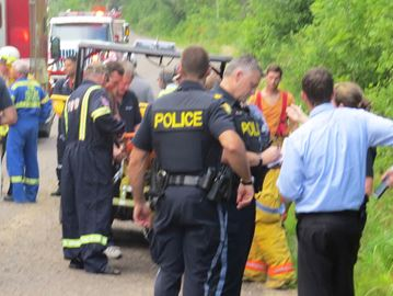 OPP and fire officials on Syer Line in Cavan - Aug. 1, 2015