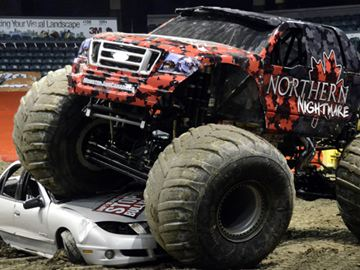 Monster truck Northern Nightmare, driven by Cam McQueen, ran over a crush car draped by a banner filled with words to describe bullying on it Friday (March 7) at Budweiser Gardens.