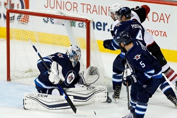 Pavelec makes 30 saves for Jets in NHL return-Image1