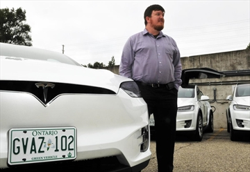 Wroute president Jason Hammond stands with some of the company's fleet of 10 Tesla Model X SUVs at its Manitou Drive office. Wroute is launching a passenger transportation service between Waterloo Region and Guelph.