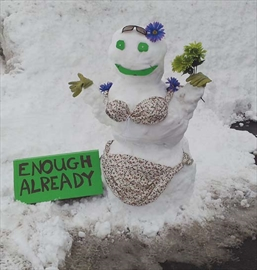 A snowgirl on York Mills Drive tells Mother Nature how she feels about our long, cold winter.