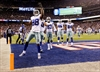 Romo throws 2 3rd quarter TDs to upstage Beckham-Image1