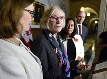 Two hundred and forty former residential school students who suffered abuse at the hands of other students will receive compensation from the federal government. Minister of Crown-Indigenous Relations and Northern Affairs Carolyn Bennett, speaks during a press conference, as Minister of Indigenous Services Jane Philpott, left, Minister of Justice and Attorney General of Canada Jody Wilson-Raybould, and Minister of Families, Children and Social Development Jean-Yves Duclos look on, in the House of Commons on Parliament Hill in Ottawa on Wednesday, Feb. 14, 2018. Bennett today says the government is embarking on a negotiated settlement with these students who she says may not have received fair compensation under the previous process. THE CANADIAN PRESS/Justin Tang