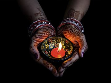 Diwali - woman holding a lit candle