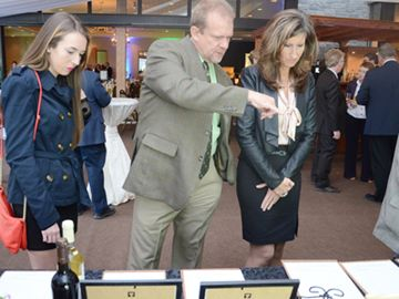 Jessica Kemp (left), dad Brian and mom Susan Kemp look at items in the silent auction at the 25th Annual Conservation Dinner by the Lake Simcoe Conservation Foundation in aid of the Lake Simcoe Region Conservation Authority at The Manor in King City on Wednesday evening June 5.