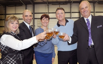 Steeped Tea  Cathie Coward,The Hamilton Spectator   Steeped Tea is enjoying huge success as it branches into the United States. From left to right: U.S. sales head Belinda Ellsworth, stands with owners Hatem Jahshan, Tonia Jahshan, and Dragons David Chilton and Jim Treliving at the grand opening of Steeped Tea space in the Ancaster Industrial Park.