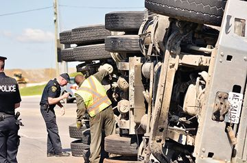 A gravel truck rolled over as the driver was turning east onto Green Lane from northbound Hwy. 404 June 19. The driver was taken by ambulance to  hospital.